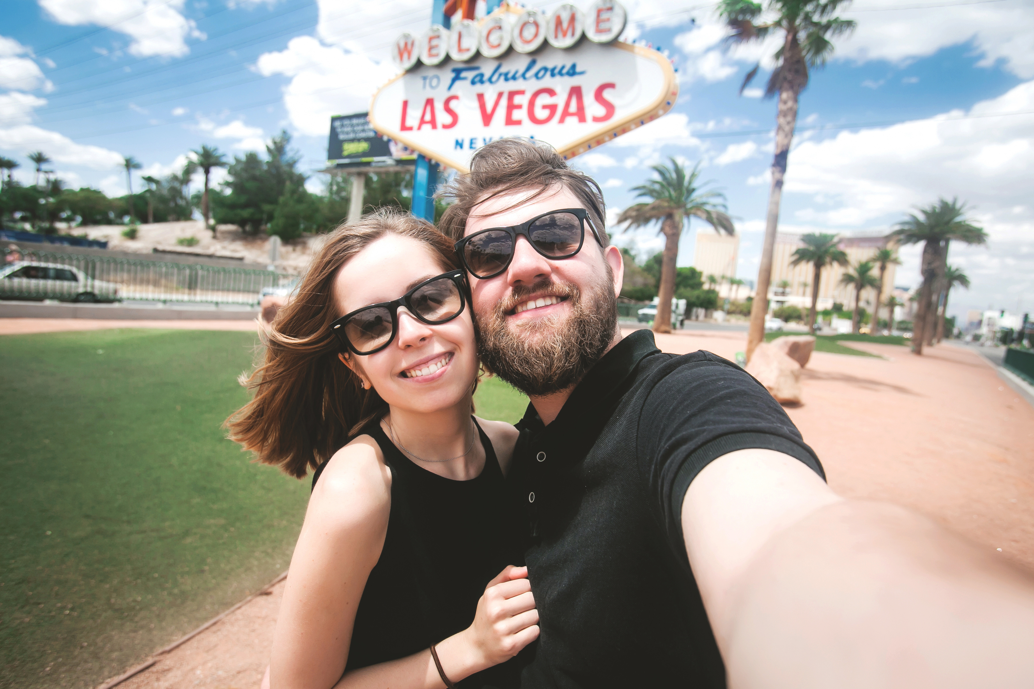 Happy couple in Las Vegas - Nevada marijuana sales vs california marijuana sales