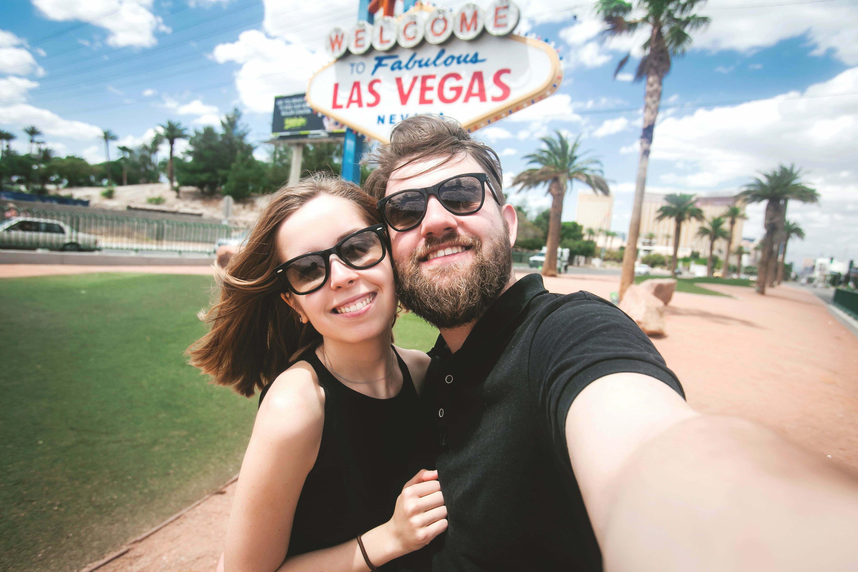Happy couple in Las Vegas - Nevada marijuana sales vs california marijuana sales